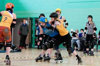 Cornwall Roller Derby Jammer Tsunami takes on a Bath Roller Girls Blocker
